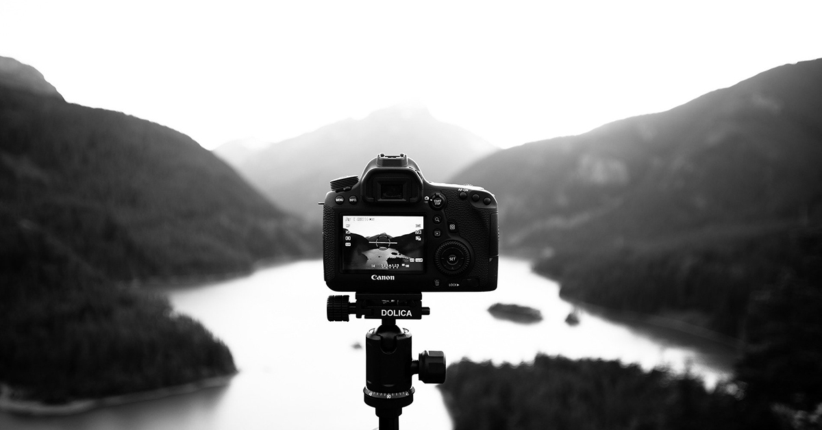 Photo Search - Camera looking over mountains and lake.