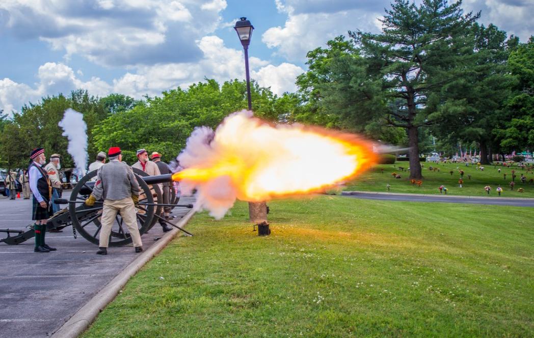 2017 Photo Search - Men dressed in civil war attire firing a cannon.