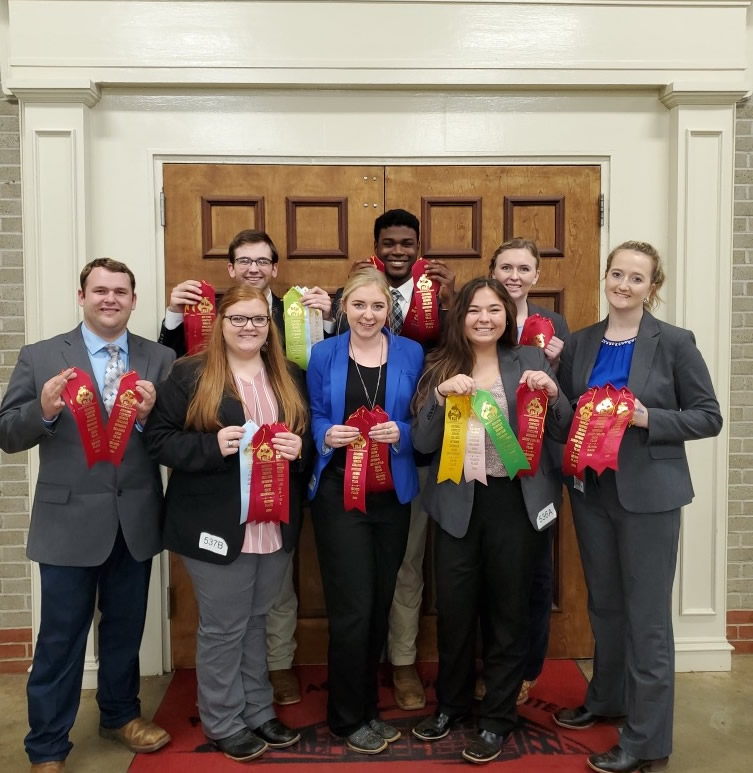 Livestock Judging team with their award ribbons