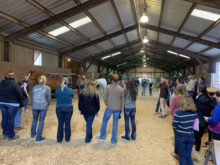 image of agents and participants attending a horse conference