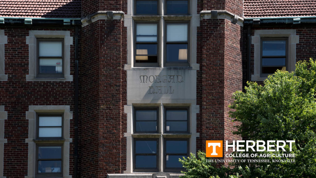 A close-up of the front of Morgan Hall with the Herbert College of Agriculture logo in the bottom right corner