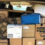 Picture of moving boxes in the back of a minivan