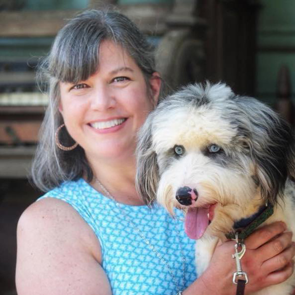 Picture of Karen Armsey holding a dog