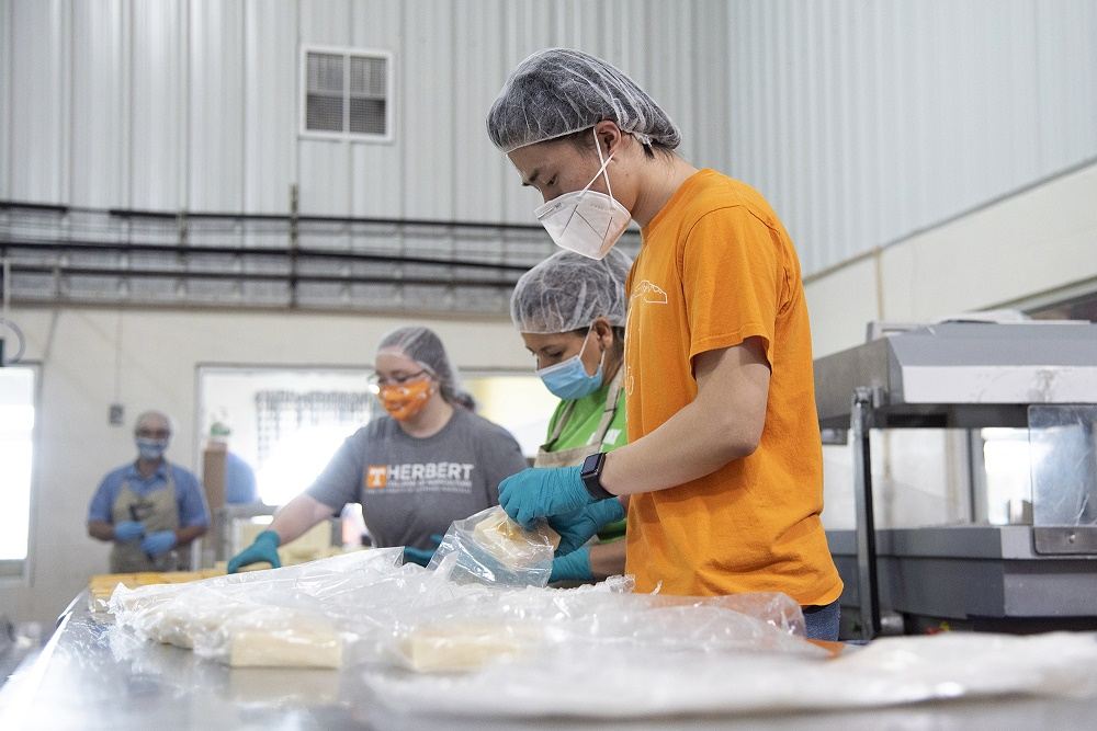 Picture of students packaging cheese