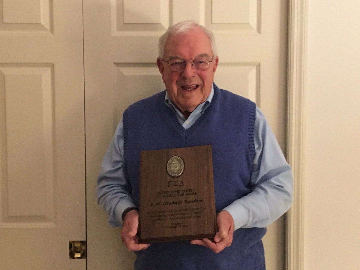 Picture of Buddy Sanders with his award
