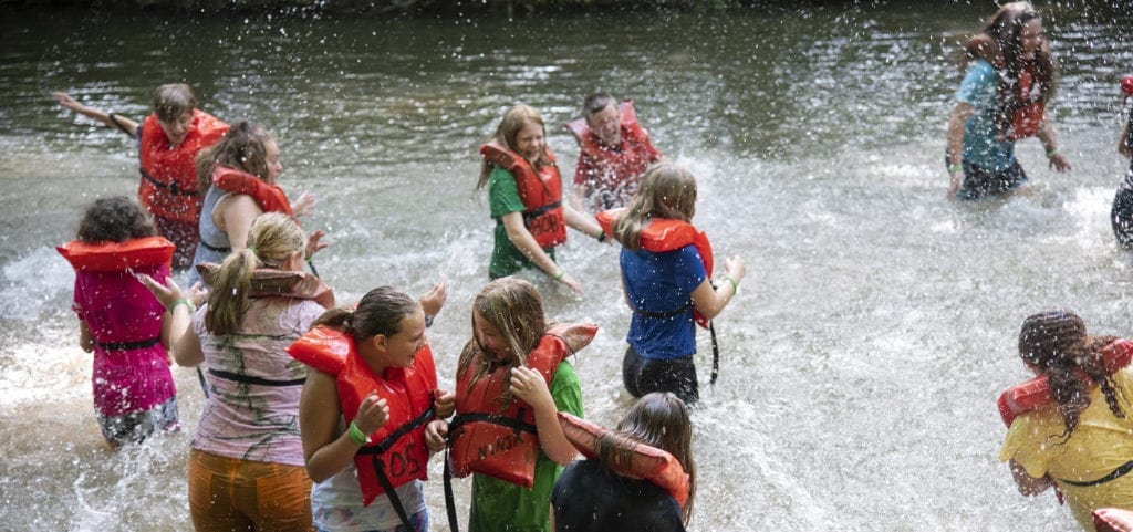 Children splashing in a creek